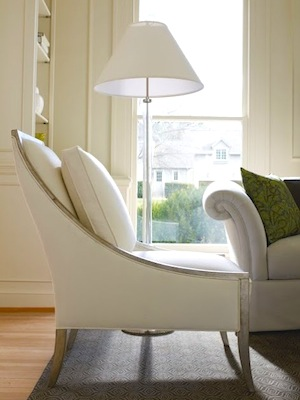 floor lamp tying in well with the living room decor