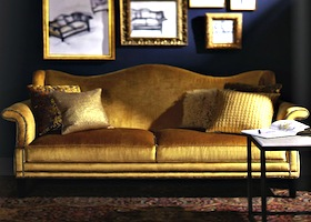 Goldish sofa matching the frames and the motif of the living room