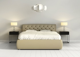 Chic tufted leather bed in contemporary chic bedroom front