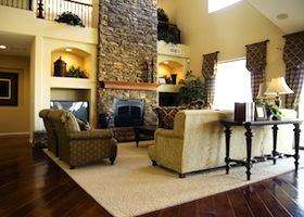 Beautiful large executive home living room area with lush polished hardwood flooring