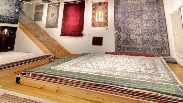 oriental rugs on floor and wall