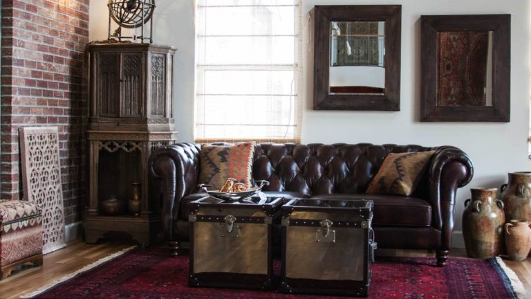 darker leather sofa to match the dark hardwood floor and an Oriental rug