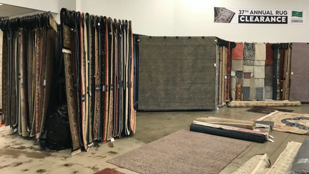 Ibraheems 5090 Acoma St, Denver, CO 80216 Showroom showing 37th annual rug clearance banner