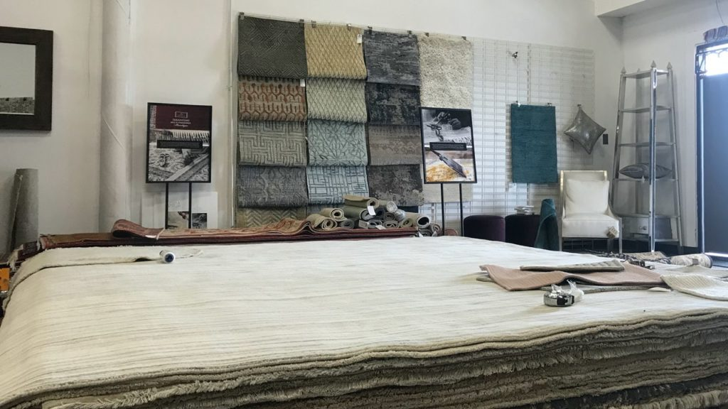 Ibraheems 5090 Acoma St, Denver, CO 80216 Showroom showing multiple rugs