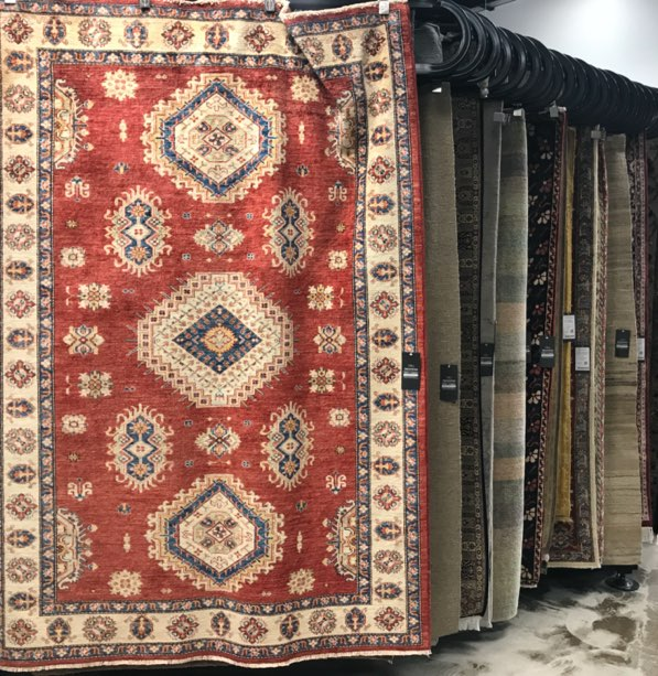 Ibraheems 5090 Acoma St, Denver, CO 80216 Showroom showing multiple persian rugs